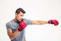 Side view portrait of a handsome man boxing Stock Photo