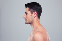 Side view portrait of a handsome man. Side view portrait of a handsome muscular man over gray background Stock Photography