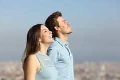 Happy couple breathing fresh air with urban background stock photos