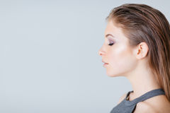 Side view portrait of a lovely woman Royalty Free Stock Image