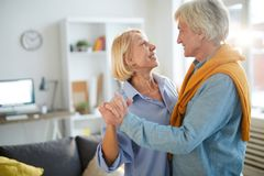 Mature Couple Dancing at Home royalty free stock photos
