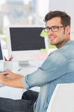 Side view portrait of a male artist using computer. In the office Royalty Free Stock Images