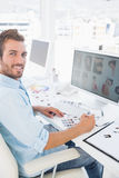 Side view portrait of a male photo editor working on computer Stock Image