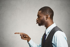 Side view portrait man pointing at someone accusing in wrong doi Royalty Free Stock Image
