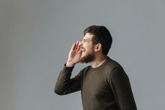 Side view portrait of a man shouting Royalty Free Stock Images