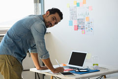 Side view portrait of man working at office Stock Photography