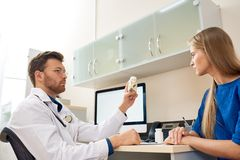 Doctor Giving Vitamins to Patient Stock Image