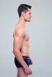 Side view portrait of a muscular man Royalty Free Stock Photo