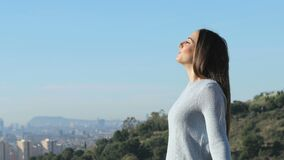 Woman breathing fresh air far from city stock footage