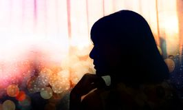 Side View Portrait of a Sadness Woman, Hand on Chin, Silhouette Stock Images