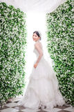 Side view portrait of smiling bride standing amidst flower decorations Royalty Free Stock Images