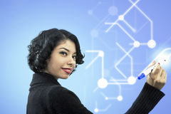 Side view portrait of smiling businesswoman writing of visual screen Royalty Free Stock Images
