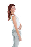 Side view portrait of a smiling casual young woman Royalty Free Stock Photography