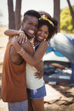 Side view portrait of smiling couple standing against tent Stock Images