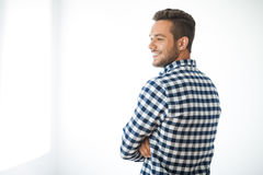 Side view portrait of smiling handsome man on white background. With copy space Royalty Free Stock Photography