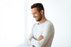 Side view portrait of smiling handsome man on white background. With copy space Royalty Free Stock Image