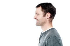 Side view portrait of smiling man Royalty Free Stock Photo