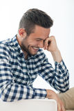 Side view portrait of smiling shy man Stock Images