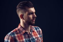 Side view portrait of stylish young man looking away Stock Photography