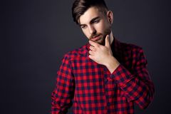 Side view portrait of stylish young man looking away Royalty Free Stock Image