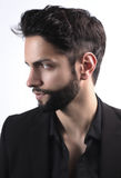 Side view portrait of  stylish young man wth a modern hairstyle. On a white background Royalty Free Stock Photos