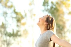 Woman breathing fresh air outdoors in summer Royalty Free Stock Photography