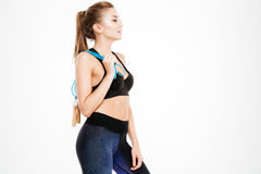 Side view portrait of woman in sportswear with skipping rope Royalty Free Stock Photography