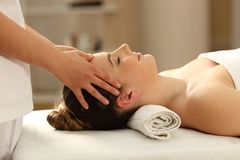 Woman relaxing receiving a facial massage Royalty Free Stock Images