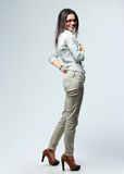Side view portrait of a young cheerful businesswoman standing Royalty Free Stock Photos
