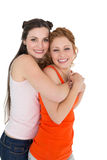 Side view portrait of a young female embracing her friend Stock Image