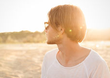 Side view portrait of a young guy in sunglasses Royalty Free Stock Photography