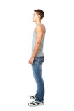 Side view portrait of young man. Full length side view portrait of young man isolated on white background Royalty Free Stock Photo