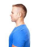 Side view portrait of young man. Side view portrait of smiling young man isolated on white background Royalty Free Stock Image