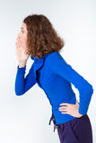 Side view portrait of a young woman shouting Stock Photos