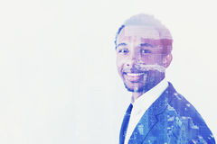 Side view of positive African businessman and city Royalty Free Stock Image