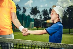 Happy child shaking hand of man royalty free stock photo