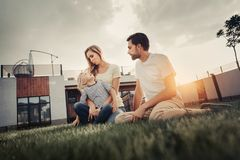Satisfied couple with kid having leisure outside royalty free stock photography