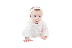 Side view of pretty baby girl crawling on floor Royalty Free Stock Photo