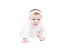 Side view of pretty baby girl crawling on floor Stock Photography
