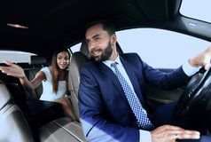 Side view of pretty couple in car. cropped image. Stock Photography