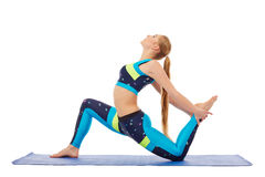 Side view of pretty young woman doing aerobics Royalty Free Stock Photography