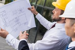 portrait of serious professional architect in hard hat looking stock image