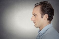 Side view profile head shot portrait sad bothered stressed man royalty free stock photo