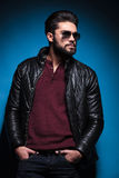 Side view profile of a young bearded fashion man in leather jack Royalty Free Stock Images