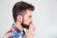 Side view protrait of a casual man praying Stock Images