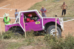 Side view of the purple off road car in terrain Royalty Free Stock Images