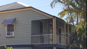 Side view of Queenslander verandah. With air conditioner in window and heritage colours Stock Photos