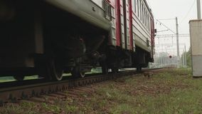 Side view of rails an train moving on them. slow motion view. Side view of rails an train beginning to move on them stock video footage