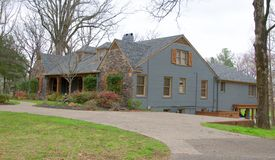 Side View of Ranch Style Cobblestone and Gray Home. Side view of two-Story Cobblestone Ranch Style Home located in Collierville, Tennessee, just outside of stock image