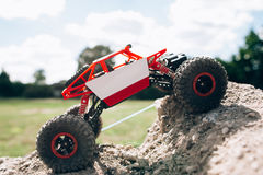 Side view on rc crawler rising to rock hill Stock Photos